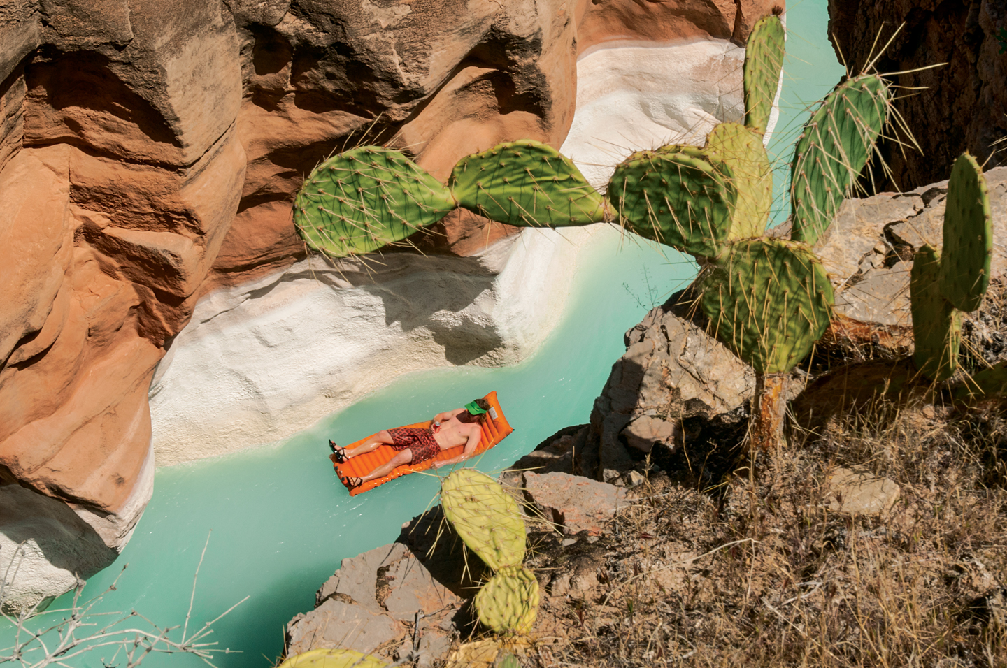 S18_PHOTO RIGHTS EXPIRE July 15, 2018: Braden Gunem floating down Havasu Creek, back to the Colorado River, on a Springtime rafting trip in Grand Canyon National Park, Arizona.