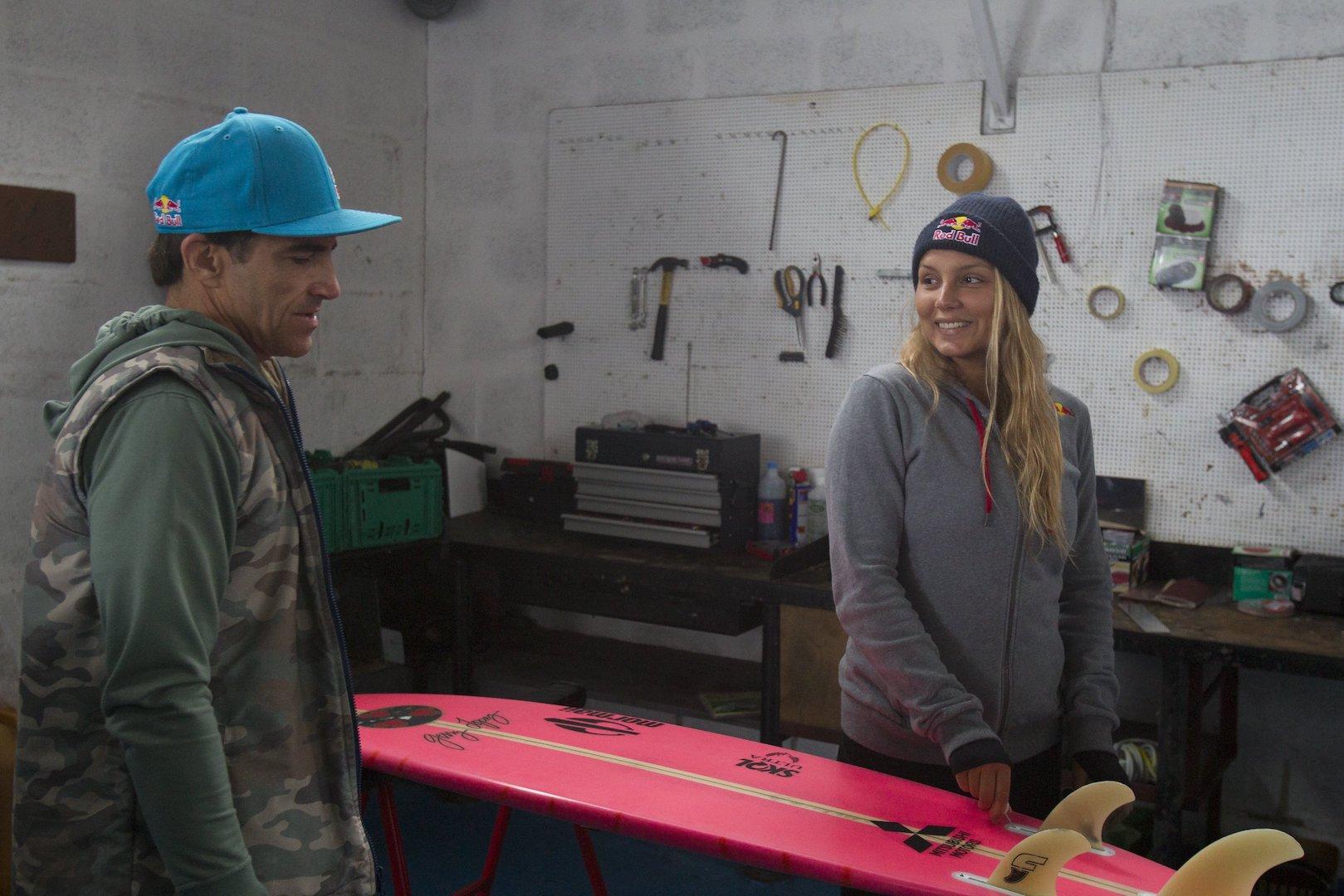 Carlos Burle and Maya Gabeira prepare their surfboards at Porto de Abrigo in Nazare, Portugal on October 11, 2015 // Hugo Silva/Red Bull Content Pool.