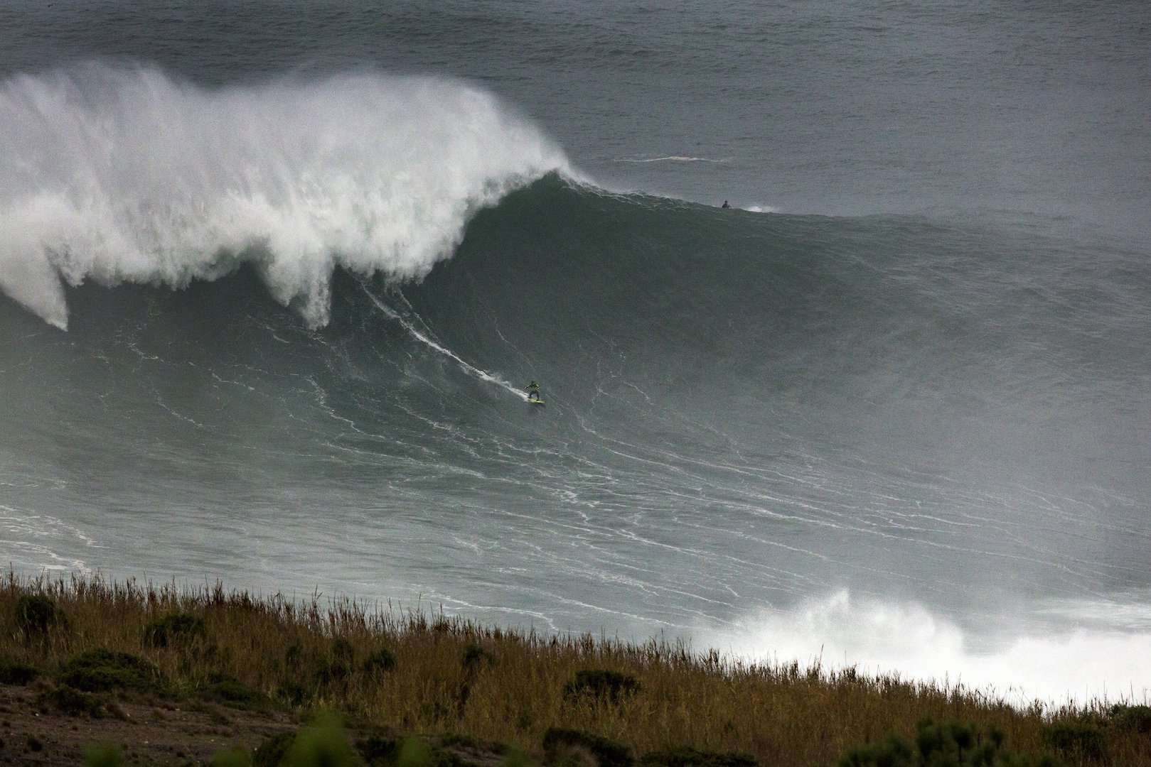 Carlos Burle surfs a big wave at Praia do Norte in Nazare, Portugal on November 01, 2015 // Hugo Silva/Red Bull Content Pool